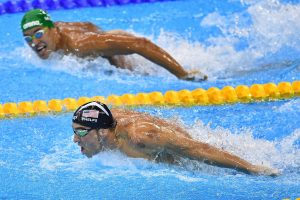 RIO DE JANEIRO, BRAZIL - AUGUST 09:  Michael Phelps (L) of the United States leads Chad le Clos of South Africa in the Men's 200m Butterfly Final on Day 4 of the Rio 2016 Olympic Games at the Olympic Aquatics Stadium on August 9, 2016 in Rio de Janeiro, Brazil.  (Photo by Pascal Le Segretain/Getty Images)